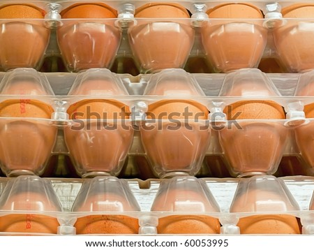 Eggs in plastic box in shop - stock photo
