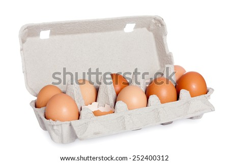 Eggs in the package isolated - stock photo