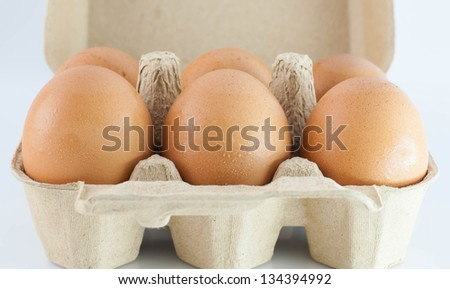 eggs in the package  isolated on white - stock photo