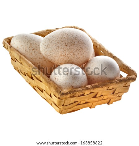 Eggs  in wicker basket   isolated on white background with clipping path  - stock photo