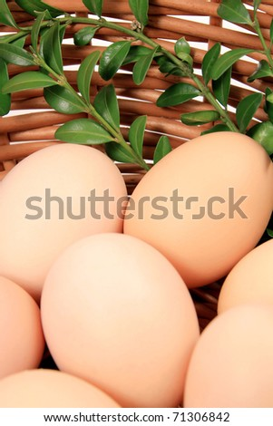 Eggs in wooden basket - stock photo