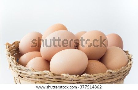 eggs in wooden basket on white background