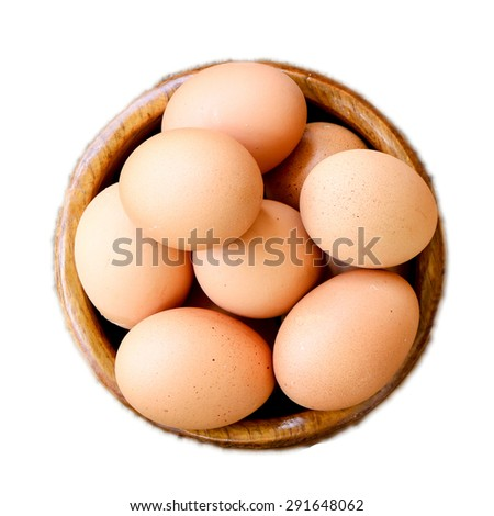 Eggs in wooden plate isolated on white background - stock photo
