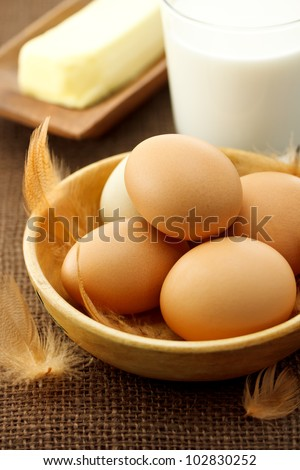 eggs, milk and butter on burlap cloth - stock photo