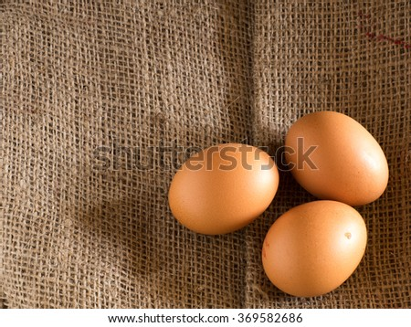 Eggs on a burlap sack.Top view