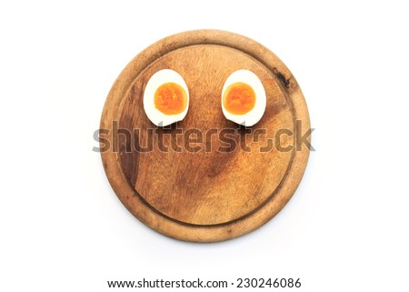 eggs on a cutting board - stock photo