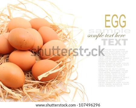 Eggs on hay nest isolated on white - stock photo