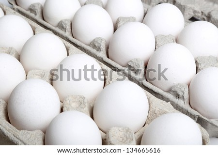 Eggs on package - stock photo