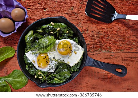 Eggs on spinach  - stock photo