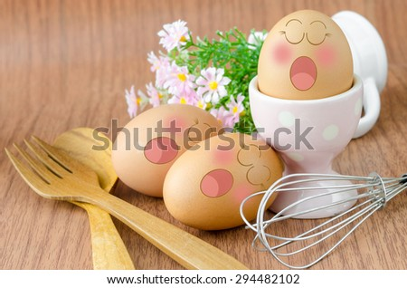Eggs sleep with Expression Face in white cup and flower on sack background. - stock photo