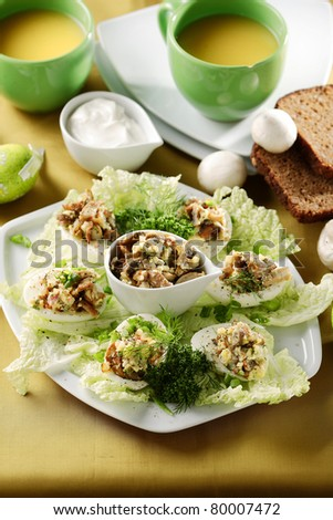 eggs stuffed with mushroom - stock photo