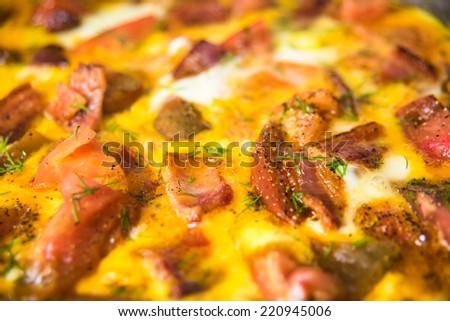 Eggs, Tomato, Bacon, and Fresh Herbs Frittata - stock photo