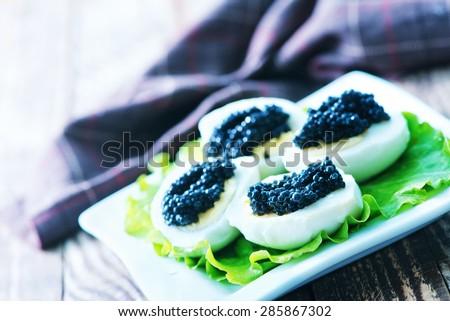 eggs with black caviar - stock photo