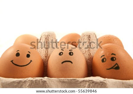 Eggs with faces. - stock photo