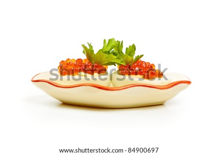 eggs with red caviar on a plate