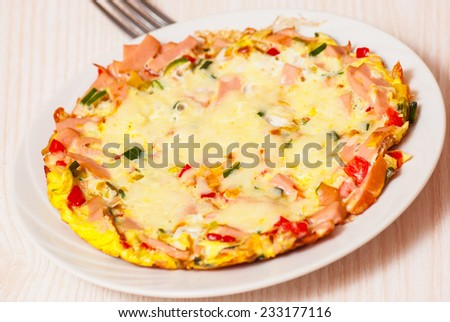 eggs with vegetables, ham and cheese - stock photo