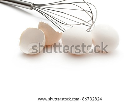 Eggs with whisk isolated on the white background - stock photo