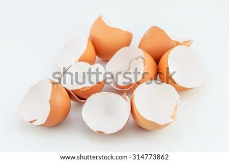 Eggshells on white background - stock photo