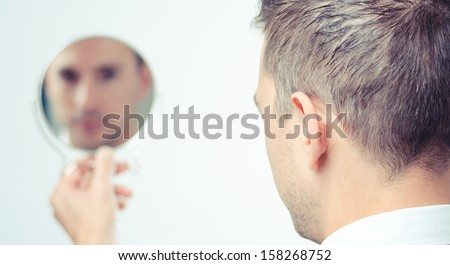 ego man reflection in mirror on a white background - stock photo