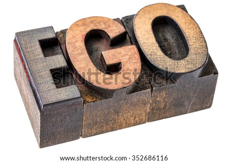 ego word in vintage wood letterpress printing blocks, stained by color inks, isolated on white - oversized ego concept - stock photo