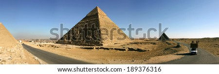 Egypt. Cairo - Giza. General view of pyramids from the Giza Plateau (three pyramids known as Queens' Pyramids, in background: the Pyramid of Menkaure /Mykerinos/, Khafre /Chephren/ and Chufu /Cheops/) - stock photo