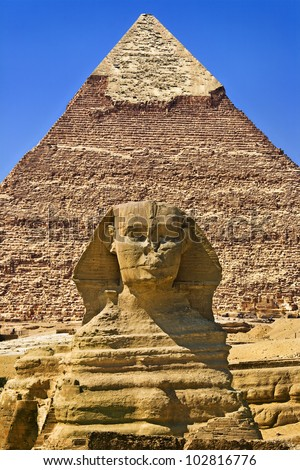 Egypt. Cairo - Giza. The Sphinx and the Pyramid of Khafre (Chephren) in background. The Pyramid Fields from Giza to Dahshur is on UNESCO World Heritage List - stock photo