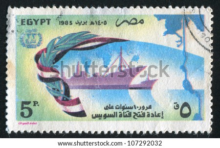 EGYPT - CIRCA 1985: A stamp printed by Egypt, shows Egyptian national flag, Ships, map of Suez, circa 1985 - stock photo