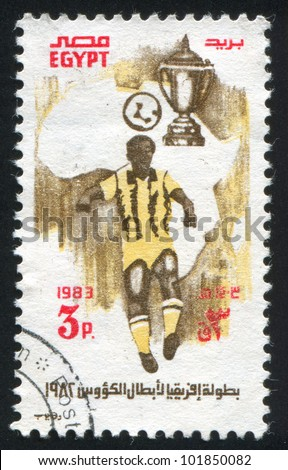 EGYPT - CIRCA 1983: A stamp printed by Egypt, shows Soccer player, map of Africa, Cup, circa 1983