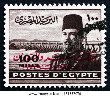 EGYPT - CIRCA 1949: a stamp printed in Egypt shows King Farouk of Egypt and Aswan Dam, circa 1949 - stock photo
