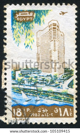 EGYPT - CIRCA 1982: stamp printed by Egypt, shows Tower Hotel, city, sailboats, circa 1982