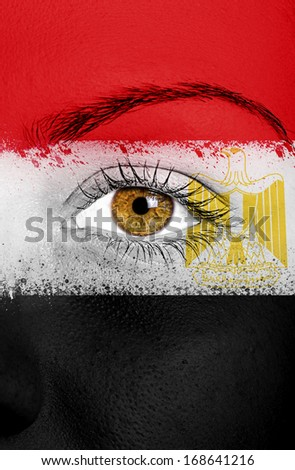 Egypt flag painted over female face - stock photo