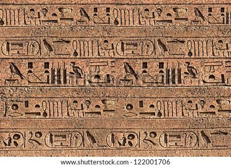 Egypt hieroglyphs on the ancient wall - stock photo