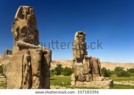 Egypt. Luxor. The Colossi of Memnon - two massive stone statues of Pharaoh Amenhotep III - stock photo