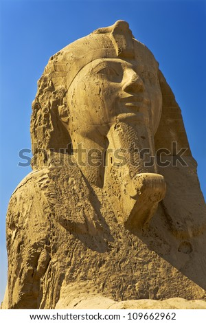 Egypt. Memphis - Mit Rahina open-air museum. The Alabaster Sphinx (face) found outside the Temple of Ptah. The Pyramid Fields from Giza to Dahshur is on UNESCO World Heritage List - stock photo