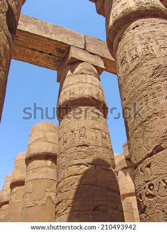 Egyptian columns with hieroglyphs at Karnak Temple, Egypt - stock photo