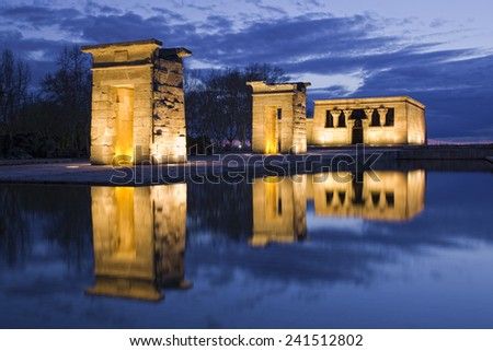 Egyptian Debod's temple reflection on water at night - stock photo