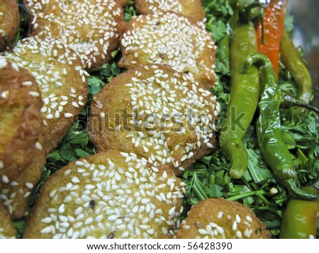 Egyptian falafel with sesame and garnish - stock photo