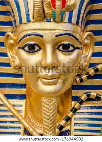 Egyptian golden pharaohs mask  - travel to Egypt concept  - stock photo