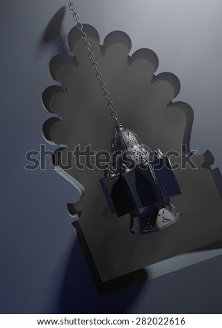 """Egyptian lantern or as we call it in Egypt """"Fanoos"""", hanging from mosque window - stock photo"""