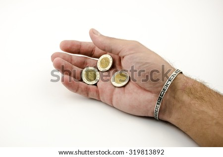 Egyptian money in hand - stock photo