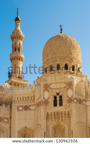 Egyptian Mosque Dome and Minaret over Blue Sky