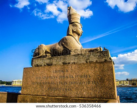 Egyptian sphinx on quay of the Neva river against cloudy sky in Saint-Petersburg, Russia.
