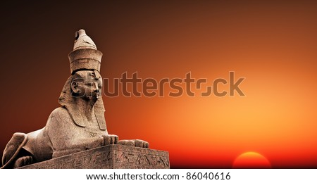 Egyptian Sphinx on the sunset sky background - stock photo
