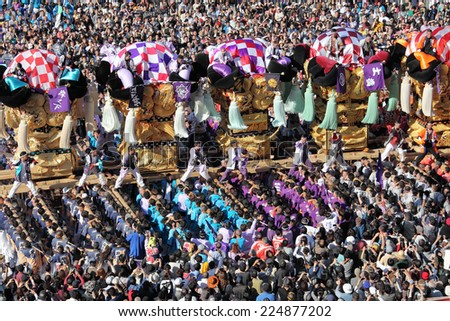 EHIME, JAPAN - OCTOBER 17: Golden large shrine festival on october 17, 2014 in Nihama, Ehime, Japan. This is the traditional event in autumn of Japan.