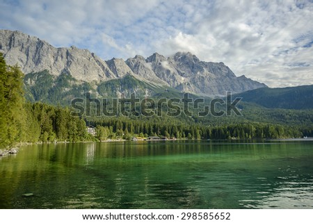 Eibsee lake and Zugspitze, at 2,962 meters, is the highest peak of the Wetterstein Mountains as well as the highest mountain in Germany, Europe - stock photo