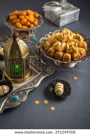 Eid and ramadan festive food and elements. Various festive special food with lantern. - stock photo