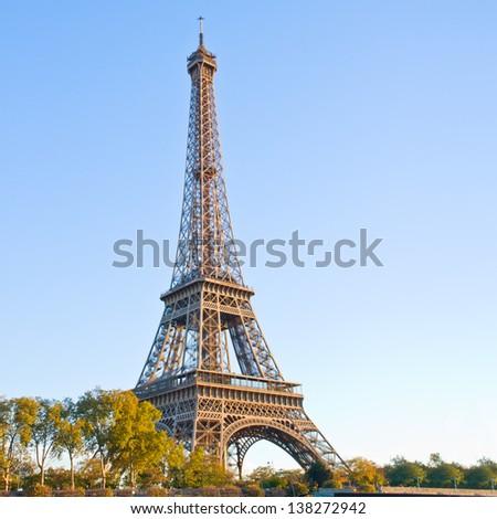 eiffel tour over green trees, Paris,  France - stock photo