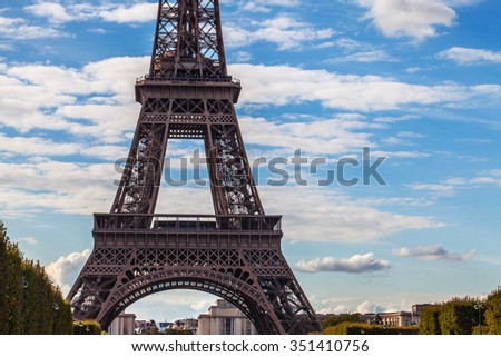Eiffel Tower against blue sky. Close-up part.