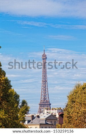 Eiffel Tower against the blue sky and clouds. Paris. France. - stock photo