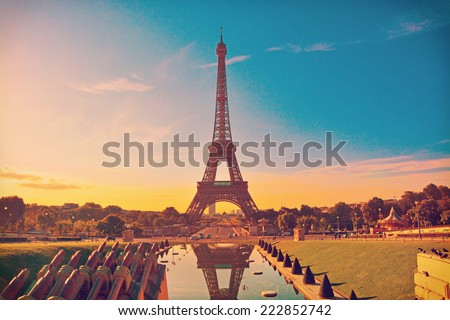 Eiffel Tower and fountain at Jardins du Trocadero at sunrise in Paris, France. Travel background with retro vintage instagram filter - stock photo